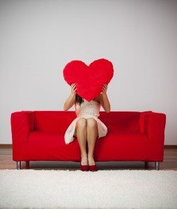 Woman-Holding-Heart-Pillow